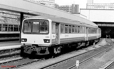 3-car DMU 144 018 is seen at Leeds on 24th May 1990.