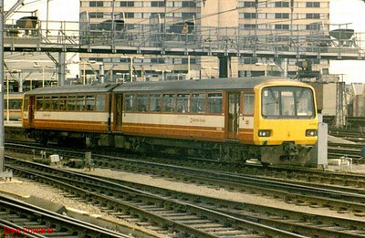West Yorkshire Metro liveried DMU 144 005 is seen here at Leeds.2-car