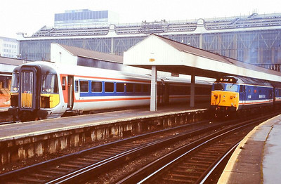"""Class 442 5-car EMU 2412 and 'Hoover' 50029 """"Renown"""" are seen at Waterloo on 5th December 1989."""