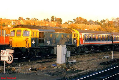 Class 33/1 33109 propels 4TC 8015 away from Basingstoke with a weekend Portsmouth Harbour to Reading working. Possibly 1988.