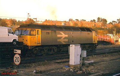 Large logo Railfreight 47213 passes Basingstoke in the late afternoon with a trainload of vans from Southampton. Possibly 1988.