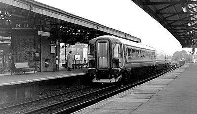 Class 442 EMU 2401 runs into Basingstoke with a Waterloo-Weymouth service on 7th November 1990.