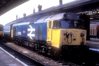 "Large logo blue 'Hoover' 50009 ""Conqueror"" awaits departure time at Salisbury with an Exeter-Waterloo train. June 1989."