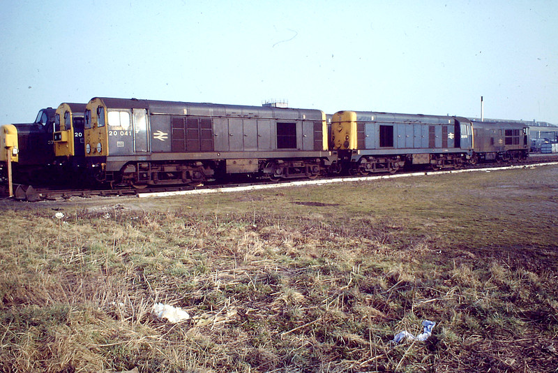 'March Diesel Depot - locos down the Old Hundred, Feb 82'. 20041 and 20079, plus the pair behind them, have probably worked through from Toton or elsewhere in the Midlands. They were not often allowed east of March, their trains taken on by a March Class 31 or 37.