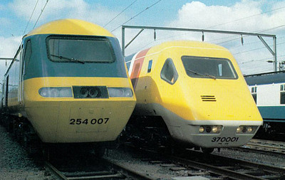 HST set 254 007 and APT-E set 370 001 sit side by side at Glasgow Shields Road Depot, 09/78 - note the lower profile of the APT set necessitated by it's tilting characteristics.