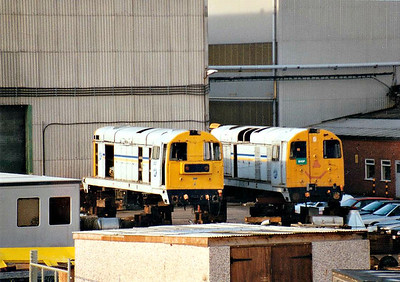 RFS Class 20's nos. 2007 (left) and 2003 mounted on blocks in the Brush Traction Works at Loughborough, 09/10/96. 2007 was ex-BR 20 175, withdrawn 07/91 and sold to RFS for Channel Tunnel duties, being cut up by HNRC 12/03. 2003 was ex-BR 20 113, withdrawn 08/91 and thereafter suffered a similar fate to 2007.