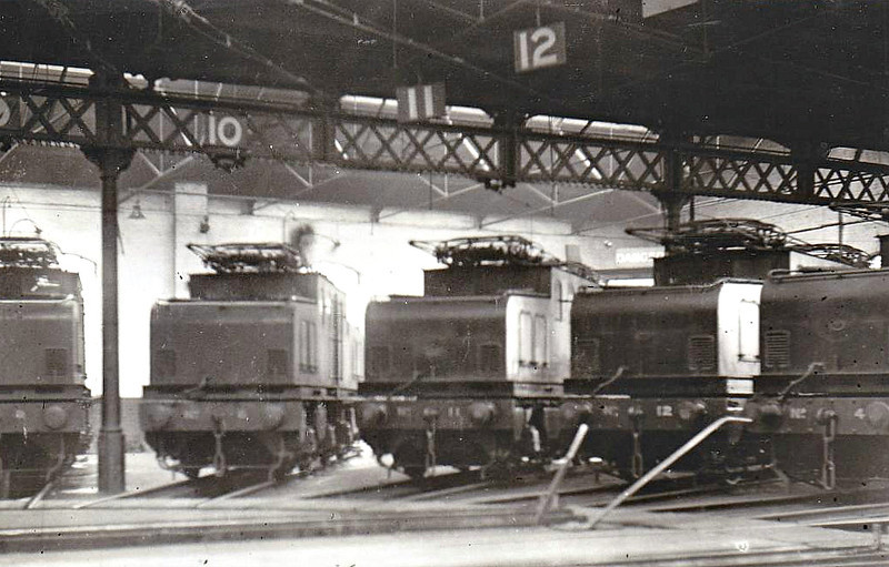 Class EB1 - NER Raven 1500 vDC Bo-Bo Electric - built between 1914 and 1919 by Darlington Works - 01/35 all to store at Darlington, LNER Nos.6490-6499, BR Nos.26502-26511 - 08/50 all withdrawn except for 26510, ex-No.11, 01/59 renumbered to No.100 in Departmental series, to Ilford EMD as shunter, 20ithdrawn 04/64 - seen here, right to left, 4, 12, 11, 5 and 6 in Shildon roundhouse, 05/32.