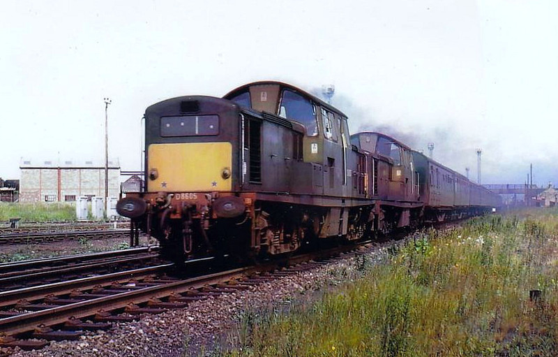 Class 17 - D8605 - Clayton Type 1 Bo-Bo DE - built 1965 by Beyer Peacock - withdrawn 10/68 - seen here with an unidentified sister loco on a passenger train in Scotland, 06/66.