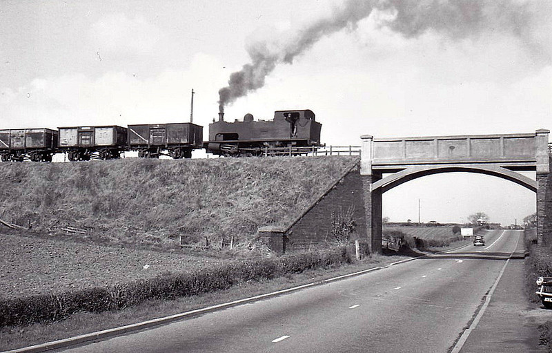 NATIONAL COAL BOARD, Ifton Colliery - UNITY - 0-6-0T - built 1927 by Hudswell Clarke & Co., Works No.1587 - seen here about to cross the A5 with a train of empties, 03/67.