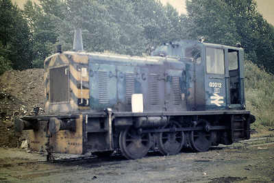MAYER NEWMAN LTD, SNAILWELL - This scrapyard had a number of ex-BR shunters over the years. 03 012, looking rather battered and devoid of any form of train brakes, was withdrawn by BR in December 1975. Seen here on 22/08/85.