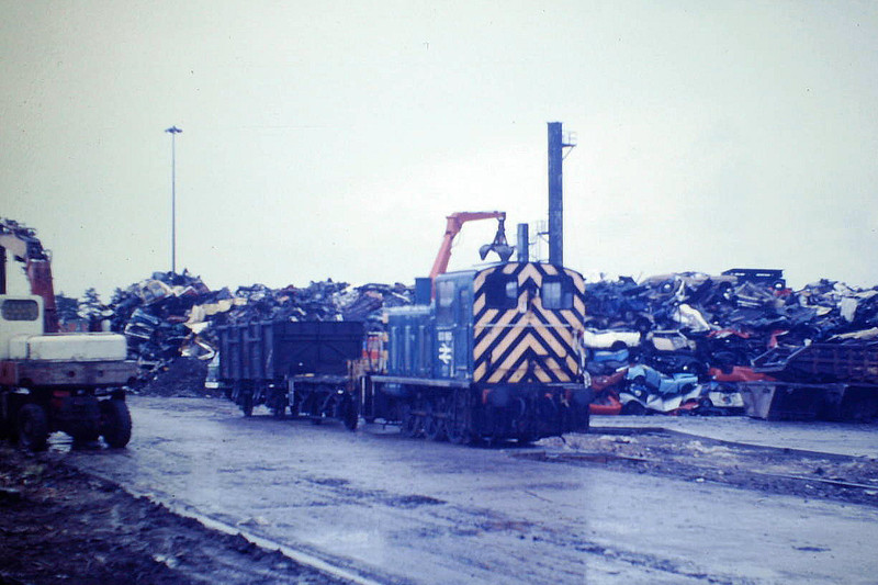 MAYER NEWMAN LTD, SNAILWELL - This scrapyard had a number of ex-BR shunters over the years. 03 180 was withdrawn by BR in March 1984 and worked at Mayer Newman's for some years. The loco is seen here shunting, still with its runner wagon, 02/08/85.