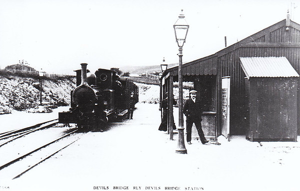 VALE OF RHEIDOL RAILWAY - Prior to acquisition by the GWR in 1923, the railway had 3 locos, Nos. 1 & 2, 2-6-2T's broadly similar to the current locos, and No.3, a 2-4-0T built 1896 by Bagnall & Co., for a Brazilian sugar plantation and acquired in 1903 from the defunct Plynlimon & Hafod  Tramway. It was withdrawn and scrapped in 1924 never having acquired it's GWR No.1198. I think this must be the loco in this picture.
