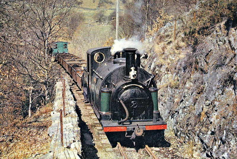 FFESTINIOG  RAILWAY - No.2 PRINCE - 597mm - 0-4-0ST with tender - built 1964 by George England & Co. for the original Ffestiniog Railway - operational - seen here with a ballast train on Creua Bank.
