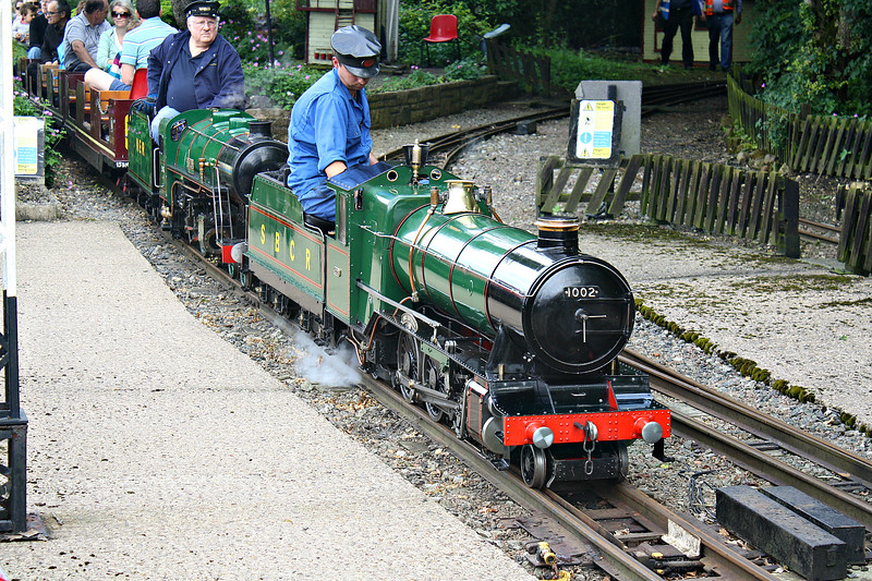 STAPLEFORD MINIATURE RALWAY - 1002 THE EMPRESS - 4-6-2 - built in 1933 by HCS Bullock for a private railway - now owned by Eastleigh Lakeside Railway - visiting loco, leading Atlantic No.751 JOHN H GRETTON into the station, 11/06/16..<br /> The Stapleford Miniature Railway is a 2 mile 260mm gauge railway in the grounds of Stapleford House. It was built in 1958 by Lord Gretton but mothballed when the house closed to the public in 1982. It has since been reopened by enthusiasts and hold two open days each year.