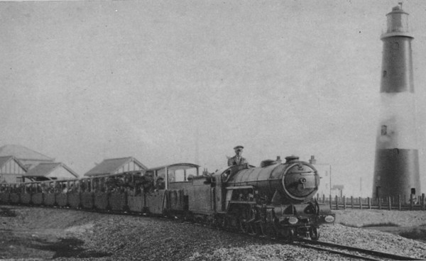 DUNGENESS LIGHTHOUSE - A packed train hauled by a Pacific passes the lighthouse as it approaches Dungeness Station.