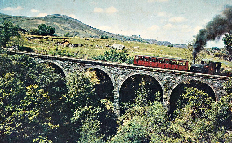 SNOWDON MOUNTAIN RAILWAY -  No.8 ERYRI - 0-4-2T - 800mm - built 1923 by Swiss Locomotive and Machine Works, Winterthur - withdrawn, dismantled and store off site - unlikely to return to service - attacking the climb over Llanberis Viaduct - posted August 10th, 1970.