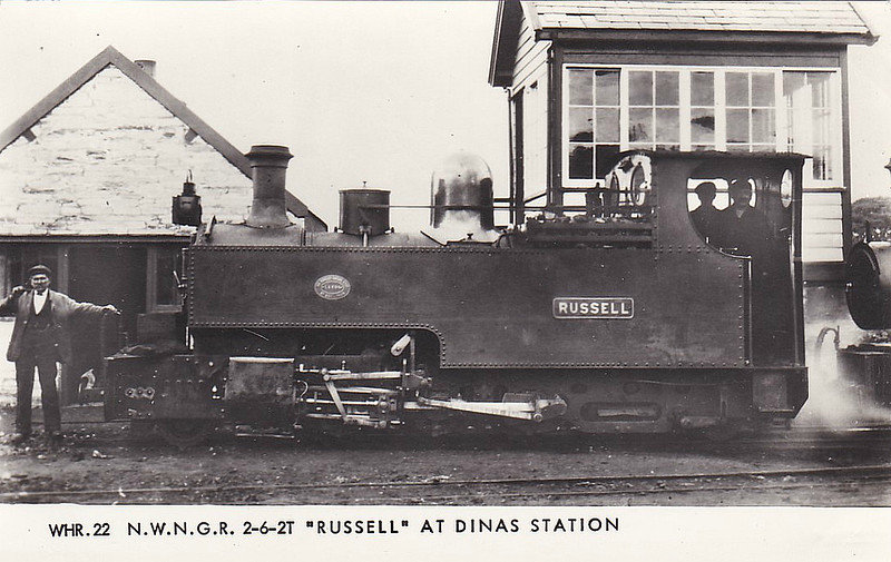 NORTH WALES NARROW GAUGE RAILWAY - RUSSELL - 2-6-2T built 1906 by Hunslet Engine Co. for the Portmadoc, Beddgelert & South Snowdon Railway - 1922 acquired by Welsh Highland Railway - 1937 withdrawn when line closed - 1942 requisitioned by WD to opencast ironstone site near Hook Norton, Oxfordshire - 1945 to Norden Clay Mines, Corfe - prone to derailment on poor track - after severe axle damage in 1953, laid up - bought for £70 and sent to Talyllyn Railway - currently undergoing restoration - seen here at Dinas Station.