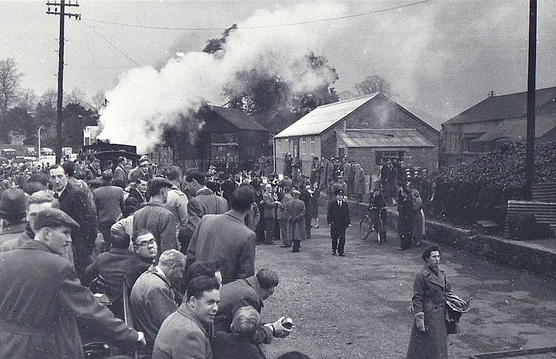 WELSHPOOL & LLANFAIR LIGHT RAILWAY - SLS 'LAST DAY SPECIAL' - The Railway officially closed on November 5th, 1956, and the SLS organised a special train on November 3rd. As the line had closed to passengers 25 years previously, there was no passenger stock available and everyone had to crowd into open wagons - here we see No.822 THE EARL awaiting departure from Welshpool - it all looks a bit 'ad hoc', don't you think? - HSE nightmare!