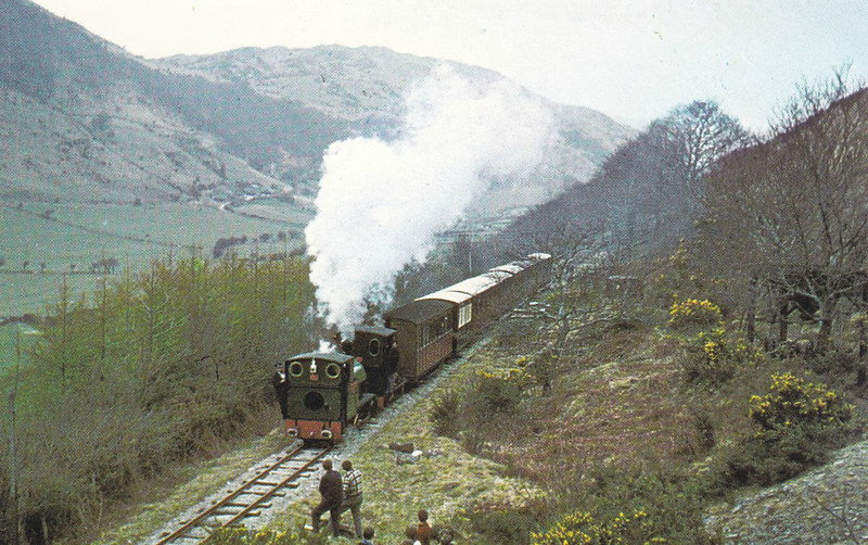 TALYLLYN RAILWAY - QUARRY SIDING HALT - About 2 miles from the inland end of the line and site of a passing loop. Here a train headed by No.4 EDWARD THOMAS and No.6 DOUGLAS pauses for a breather!