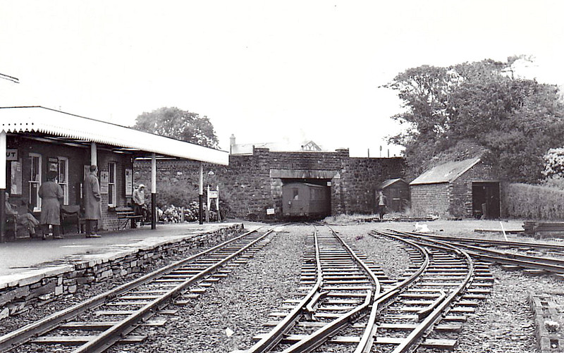 TALYLLYN RAILWAY - TOWYN WHARF STATION - Not I think a train departing but rather one backing into the station sometime in the 1960's. Not much clearance there.
