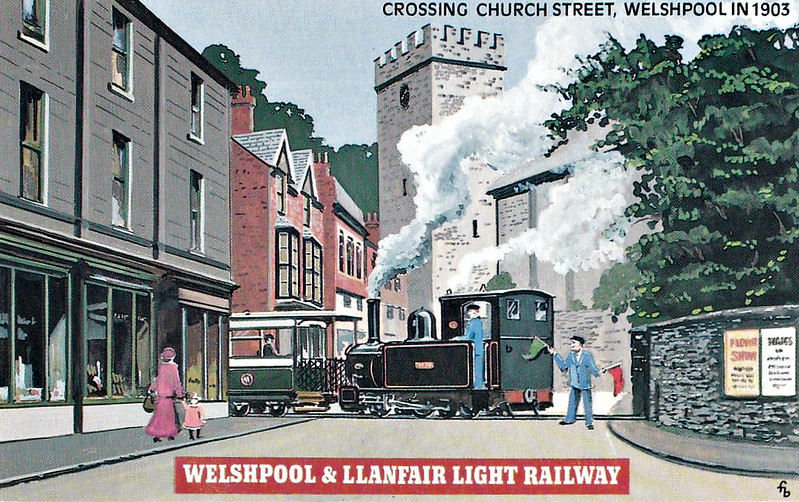WELSHPOOL & LLANFAIR LIGHT RAILWAY No.3 - The fireman flags down oncoming road vehicles as the train passes through the streets of Welshpool. Even after passenger services ended in 1931, the daily goods train still passed through the streets.