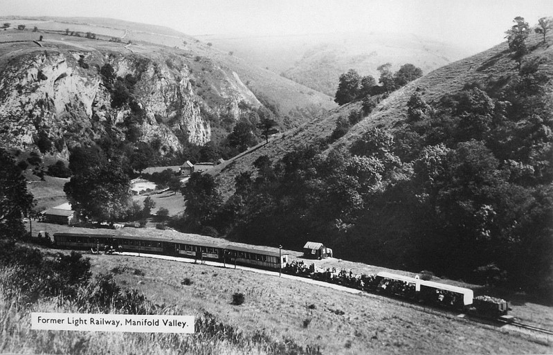 LEEK & MANIFOLD VALLEY LIGHT RAILWAY - A very busy scene in high summer as this train must consist of just about every item of rolling stock that the Company owned! Bound for Waterhouses I think as the loco is running bunker first. Note the standard gauge open wagon on the transporter wagon.