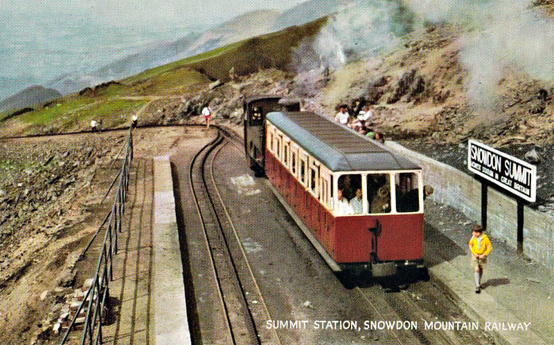 SNOWDON MOUNTAIN RAILWAY - Summit Station with a train just pulling in. All trains propel uphill and drift downhill. Clearly showing the rack system between the rails.