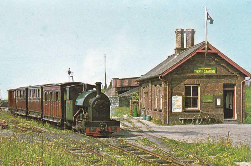 TALYLLYN RAILWAY - TOWYN WHARF STATION - Opened in 1866, called King's Station, it was the transhipment station for the slates to the Cambrian Railway. It opened for passenger services in 1911 as Towyn Wharf, being renamed to Tywyn in 1975. It is also the location of the Narrow Gauge Museum. Seen here in 1953 with No.4 EDWARD THOMAS at the head of a train.