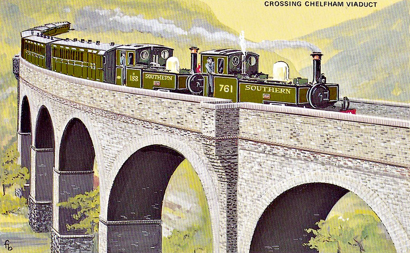 LYNTON & BARNSTAPLE RAILWAY No.4 - A major feature of the railway was the Chelfham Viaduct. Built partly on a curve with high walls, it was difficult to see much of the trains from the valley. A double-headed train makes its way to Lynton. Often this was the case with heavy trains in high summer.