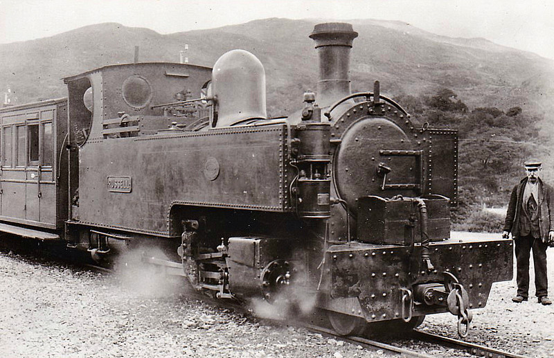 WELSH HIGHLAND RAILWAY - RUSSELL - 2-6-2T built 1906 by Hunslet Engine Co. for the Portmadoc, Beddgelert & South Snowdon Railway - 1922 acquired by Welsh Highland Railway - 1937 withdrawn when line closed - 1942 requisitioned by WD to opencast ironstone site near Hook Norton, Oxfordshire - 1945 to Norden Clay Mines, Corfe - prone to derailment on poor track - after severe axle damage in 1953, laid up - bought for £70 and sent to Talyllyn Railway - currently undergoing restoration - note cut-down cab and chimney to allow use over Festiniog Railway.