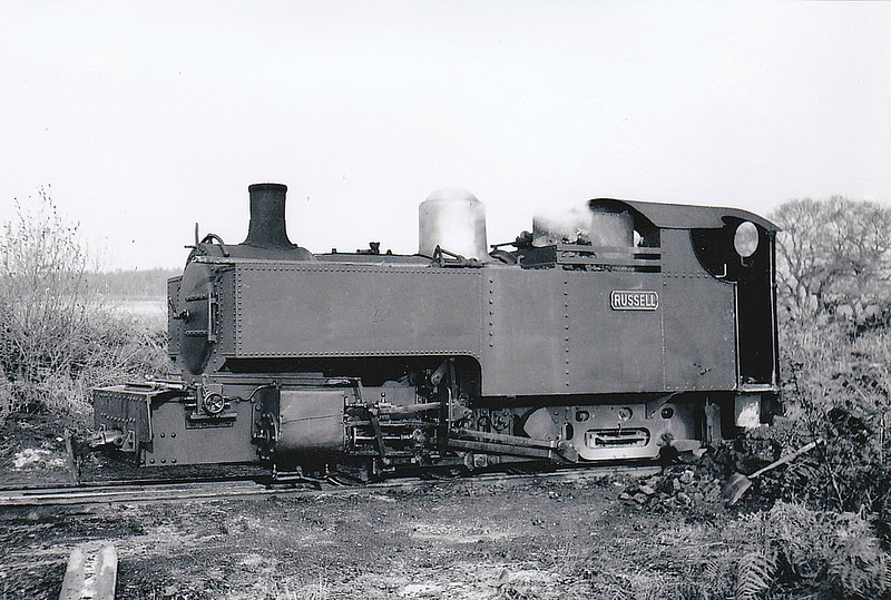 WELSH HIGHLAND RAILWAY - RUSSELL - 2-6-2T built 1906 by Hunslet Engine Co. for the Portmadoc, Beddgelert & South Snowdon Railway - 1922 acquired by Welsh Highland Railway - 1937 withdrawn when line closed - 1942 requisitioned by WD to opencast ironstone site near Hook Norton, Oxfordshire - 1945 to Norden Clay Mines, Corfe - prone to derailment on poor track - after severe axle damage in 1953, laid up - bought for £70 and sent to Talyllyn Railway - currently undergoing restoration - note cut-down cab and chimney to allow use over Festiniog Railway - seen here at Eldon Shed, Goathorn Railway, Isle of Purbeck, 12/52, running as an 0-6-2T.