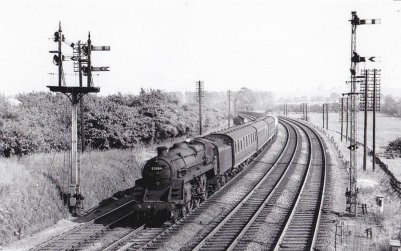 73004 - Riddles BR Class 5 4-6-0 - built 06/51 by Derby Works - 10/67 withdrawn from 9K Bolton - seen here on a local passenger at Kettering, 06/57.