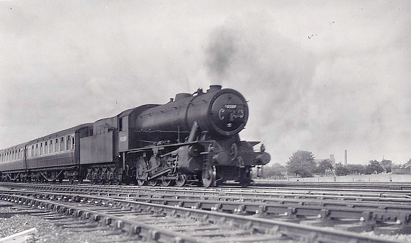90389 - WD Class 8F 2-8-0 - built 11/44 by North British Loco Co. as WD No.78596 - 11/49 to BR No.90389 - 10/64 withdrawn from10F Rose Grove - seen on an special.