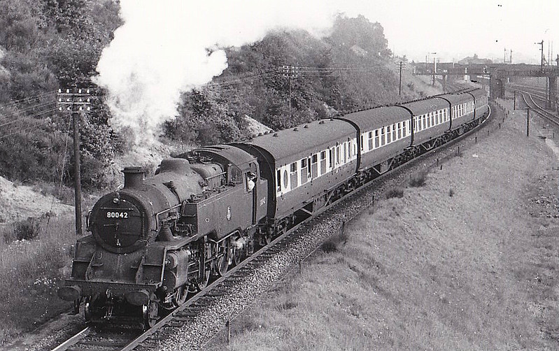 80042 - Riddles BR Class 4 2-6-4T - built 07/52 by Brighton Works - 02/65 withdrawn from 72A Exmouth Junction - seen here at Sandy on a Cambridge - Oxford train, 08/56.