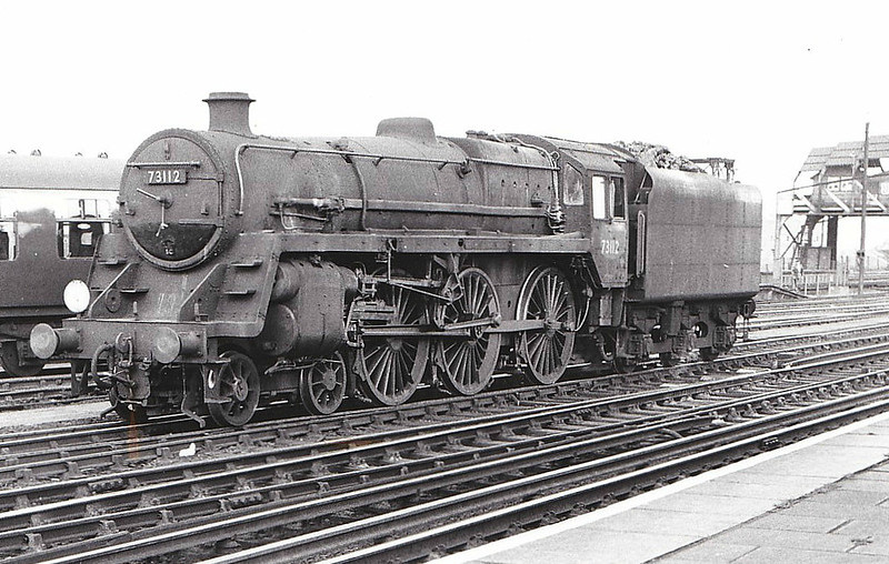 73112 MORGAN LE FAY - Riddles BR Class 5  4-6-0 - built 10/56 by Doncaster Works - 06/65 withdrawn from 70A Nine Elms - seen here at Clapham Junction in a pretty sorry state.