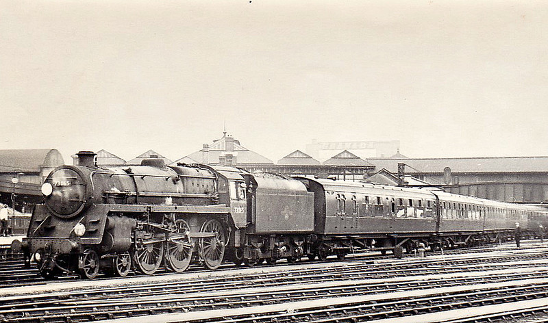 73065 - Riddles BR Class 5 4-6-0 - built 10/54 by Crewe Works - 07/67 withdrawn from 70A Nine Elms - seen here at Clapham Junction drawing a rake of ECS from the carriage sidings, 05/65.