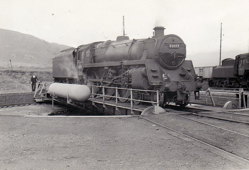 73077 - Riddles BR Class 5MT 4-6-0 - built 05/55 by Derby Works - 01/65 withdrawn from 67A Corkerhill - 03/65 scrapped by Shipbreaking Industries, Faslane - seen here at Fort William in August 1960.