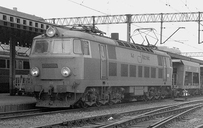 PKP electric ET22 1112 is pictured hauling a freight through Poznan Glowny on 1st March 1994.