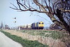 20021 and 20004 head east past Horsemoor with 6Y41 March - Kennett/Barham Redland stone, 31/03/88. The Up Redland split in March Up Yard, the larger portion going to Trowse with the train loco, the smaller to Kennett or Barham, as required, as 6Y41 with whatever March Depot could supply. The return empties also rejoined at March. Nothing in this picture remains today - both locos have been scrapped, the signals have gone, Horsemoor signalbox is in a garden in Murrow and even the willow tree fell down!.
