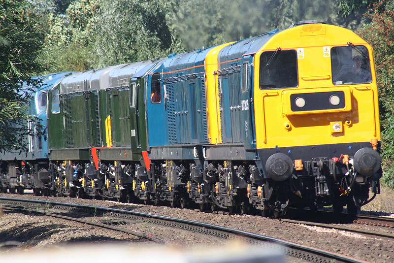 20205 and 20189 lead D8188, D8059 and D182, just emerging from behind the bushes, running as 0Z46 Derby - Dereham MNR approaching Badgeney Road AHB en route to the MNR for the forthcoming weekend's Diesel Gala, 07/09/16.