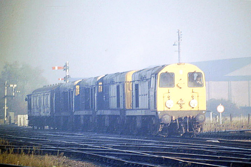 20054 and 20139 are towing away 2 of March's stored Class 20's, 20164 and 20153 to Toton Depot for component recovery, passing Whitemoor Junction, 10/87. 20054 was withdrawn in September 1989 and 20139 in May 1991. 20164 was cut by Vic Berry in Leicester in July 1988 and 20153 at Berry's in March 1988.
