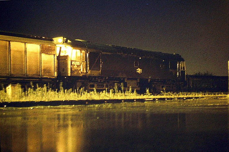 25175 sits rattling in Wisbech Yard in the pouring rain, 12/84. Pouring with rain and pitch dark (and I'm laying in a puddle!), the loco stands in the yard waiting to depart for Whitemoor, 12/84. This loco was withdrawn in December 1985.