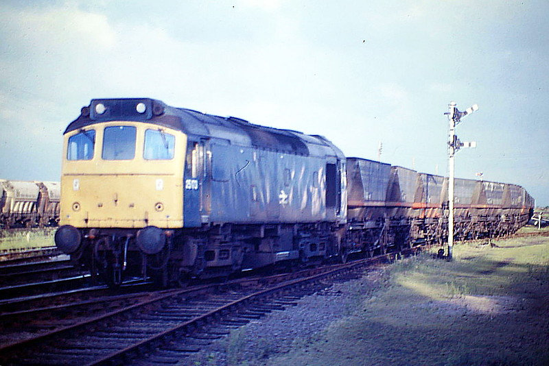 25173 leaves March Down Loop with 6E07 Foxton - Thoresby coal empties, 20/08/85. This loco was withdrawn in March 1987 and is preserved on the Battlefield Line.
