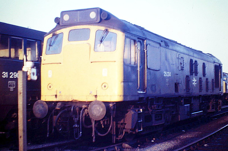 25034 catches the setting sun in Hundred Road Sidings at March Depot, 01/09/85. This loco was withdrawn in December 1986.