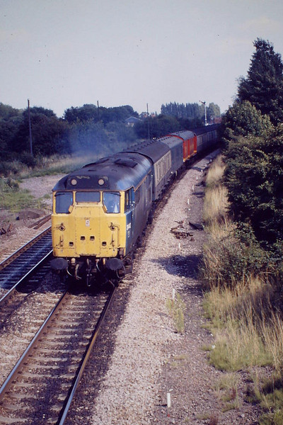 31442 approaches March West Junction on 5E45 Cambridge-Peterborough empty vans, 08/88.