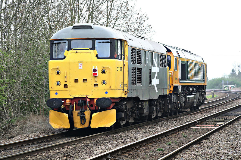 31108 is in tow by 66717 as they pass Badgeney Road AHB, forming 0G67 Orton Mere - Dereham, en route from the NVR to MNR, 03/04/14.