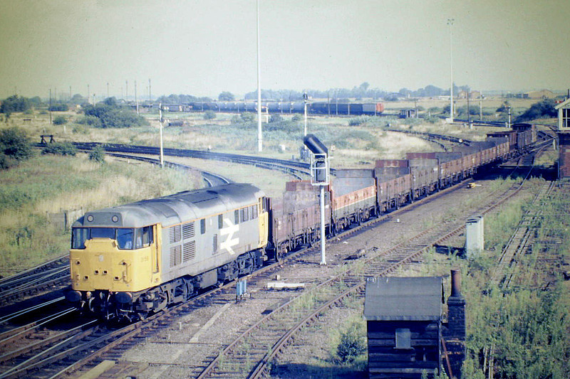 31158 leaves Whitemoor with 9H99 for Peterborough, 08/87.
