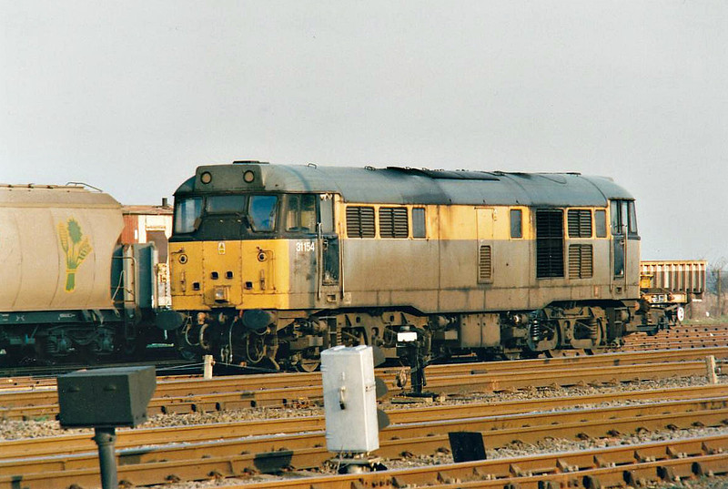 31154 sits in March Up Yard awaiting it's next turn of duty, 12/02/99. These were still a few trips freights operated from March at this time and a loco was normally detached from Peterborough to cover them. This loco was withdrawn in 09/99 and scrapped.