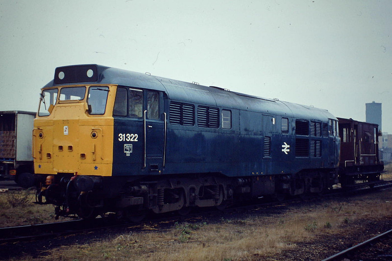 31322 waits to depart for Whitemoor from Wisbech brakevan only, Winter 1982.