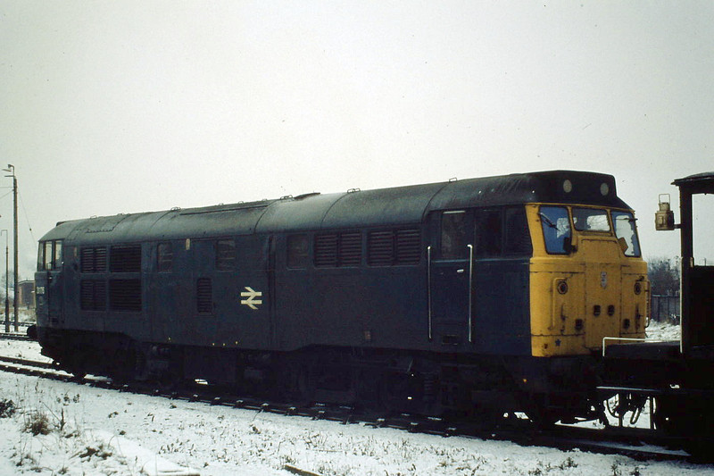 31176 waits to depart Wisbech for Whitemoor, brakevan only, Winter 1981.